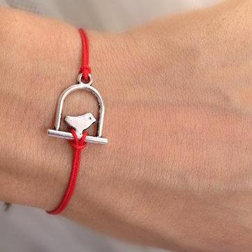 Silver bird bracelet, red rope brac..
